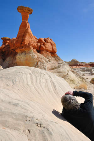 paria: Middle Aged Man Taking Photo of Paria Rimrocks Red Toadstool (Hoodoo)