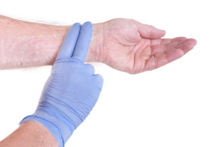 Nurse Wearing Latex Gloves Taking Pulse of a Patient