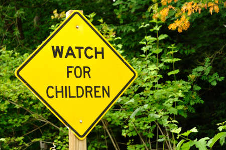 Yellow Watch For Children Road Sign Zdjęcie Seryjne