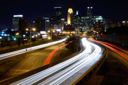 Highway Traffic and Downtown Minneapolis Minnesota at Night