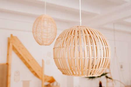 stylish minimalist bamboo chandeliers on the ceiling Standard-Bild