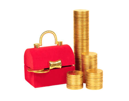 Red chest and columns of yellow coins on a white background photo