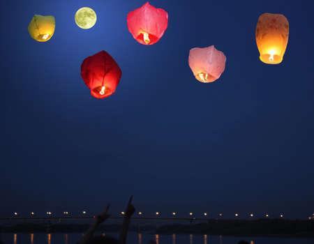 Moonlight lanterns: Multi-colored lanterns in the evening sky