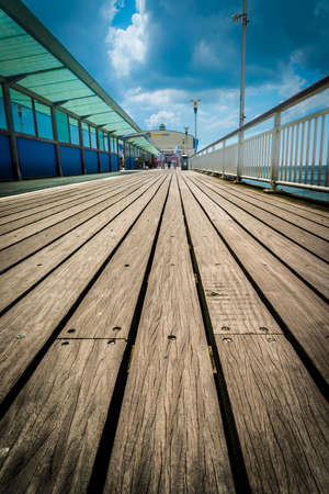 bournemouth: A low angle shot of the pier at Bournemouth in Dorset showing the teak boards.