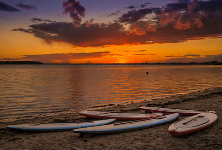 Orange glow of setting sun and calm waters in Poole Harbour Stok Fotoğraf - 31809963