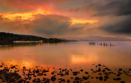 Long exposure of a Scottish loch and jetty.  photo