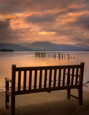 trossachs national park: Long exposure of a Scottish loch and jetty. The mountains of the Trossachs surround the loch