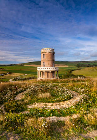 Cliff-top folly on the Dorset coast, England. The tower was dismantled and moved 30 feet away from the cliff to avoid being lost over the edge.