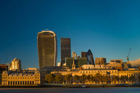 30 st mary axe: The London skyline office buildings of the city district at sunset Stock Photo