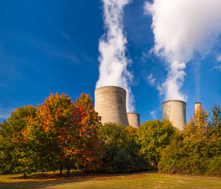 cooling towers: Clouds form over coal and gas-fired power station cooling towers at Didcot in Oxfordshire Stock Photo