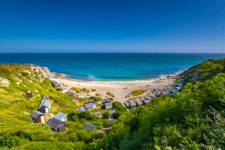 beach huts: Tucked away on the east coast of the Isle of Portland is a tiny cove with multi-coloured beach huts and white pebbles