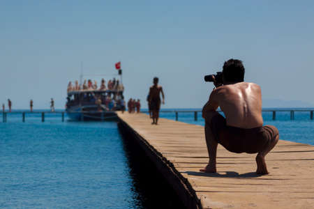 disembark: As passengers disembark from a cruise ship a photographer captures the action