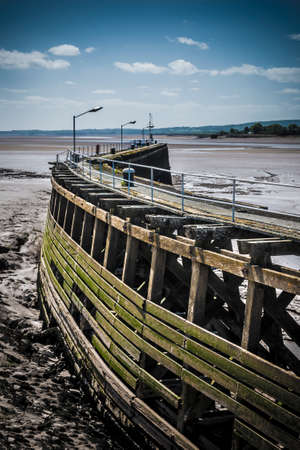 sharpness: Broken down wooden pier on the Severn Estuary at Sharpness Stock Photo