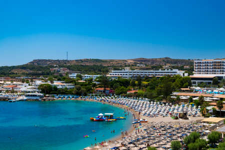 The hotels of Kallithea, Rhodes, flank a sheltered bay Stok Fotoğraf
