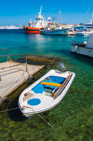 middle ages boat: Clear waters in Mandraki Harbor Stock Photo