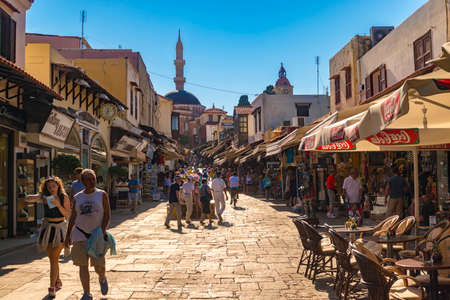 Tourists wander the streets of the old town of Rhodes