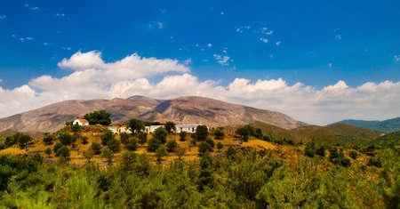 undulating: Undulating rocky hillside of the lower streches of the Ataviros mountain region Stock Photo