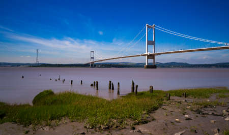 The crossing of ther river Severn seen from the muddy and rocky shoreline Stok Fotoğraf - 56753313