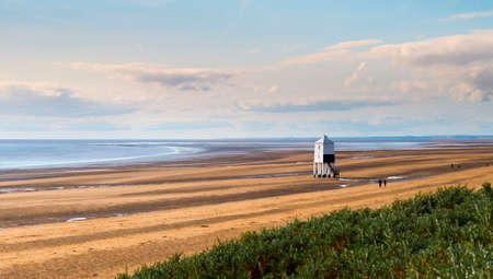 burnham on sea: Wooden lighthouse from 1932 standing tall on stilts at a Somerset beach