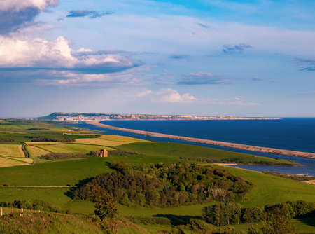 Green grass of the Dorset countryside overlooking Portland and the Fleet Stock Photo