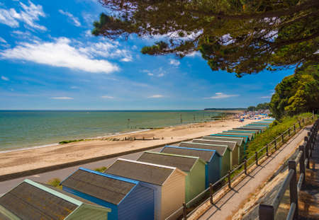 bournemouth: Blue and green beach uts line the promenade overlooking Solent Beach near Hengistbury Head and Mudeford Quay, Christchurch and Bournemouth in Dorset Stock Photo