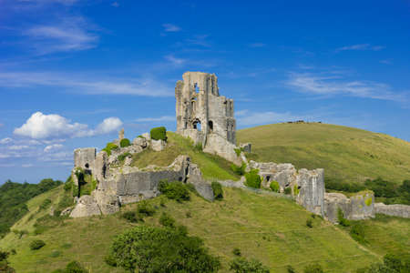 View of Corfe Castle in the Purbeck Hills of Dorset seen from West Hill