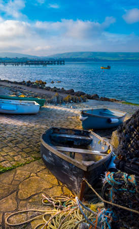 Lobster pots sit on the quayside drying in the sun Stock Photo