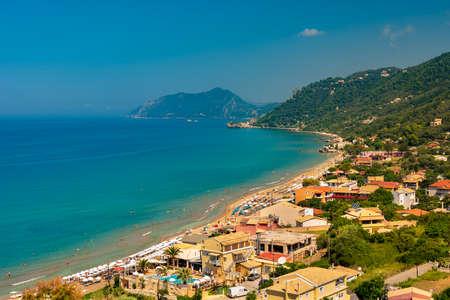Golden sands, azure seas and deep blue skies all feature as highlights of Agios Gordios village Stok Fotoğraf - 119118400