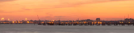 Wide angle panoramic of sunset over a Poole Harbour jetty Stock Photo