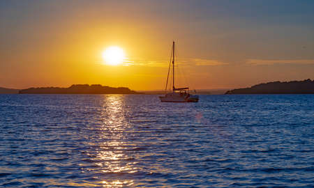 Sunlit Houseboats in Poole Harbour at sunset Stok Fotoğraf - 119118500