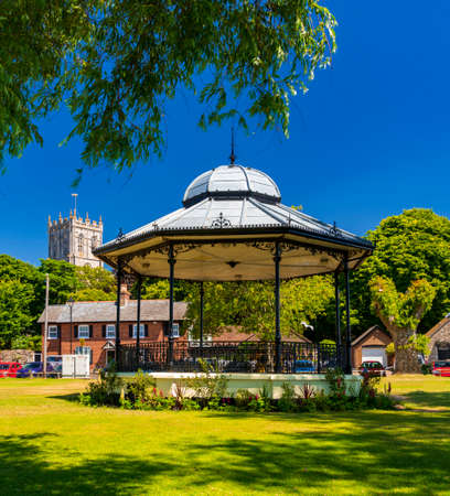 Blue skies and Bandstand with Christchurch Priory in Background Stok Fotoğraf - 119118528