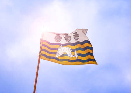 Poole's flag, based on a 14th century design, includes a dolphin and three scallops Stok Fotoğraf - 119118532
