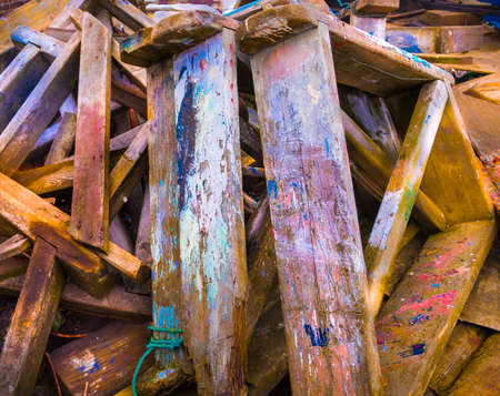 Pile of old paint splattered saw benches used in the restoration of boats at Poole Quay Stock Photo