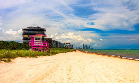 Multi-colored lifeguard station on the Miami Beach shoreline Stok Fotoğraf