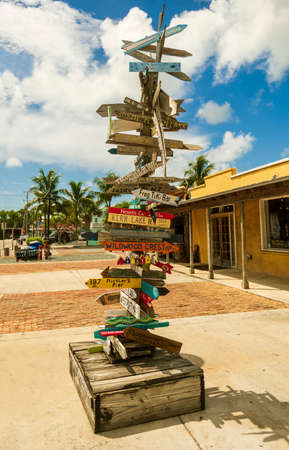 Wooden signs attached to a post in Key West, Florida Stok Fotoğraf