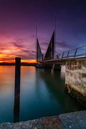 Poole harbour crossing twin sails bridge at sunset