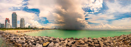 Panoramic view with a storm beyond the shoreline at Miami Beach
