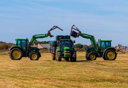 Grass cutting and Hay making at Hengistbury Head in Dorset Stok Fotoğraf