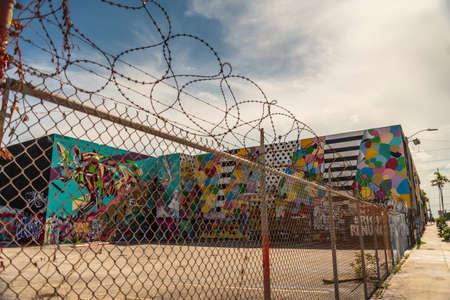 Miami, United States - July 29, 2019: Huge wall paintings adorn abandoned warehouses, stores and fences in the arts district of Wynwood Walls in Miami