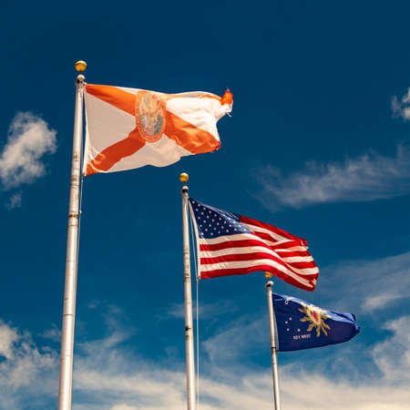 Three flags flutter in the breeze at Key West