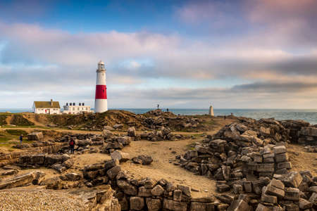Lighthouse and the Jurassic Coastline at Portland Bill in Dorset Stock Photo