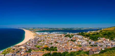 Chesil Beach and Portland Harbour with Fortuneswell on a summer day