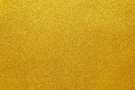 Gold sparkling festive background, close-up. Copy space for text. Horizontal. Celebration, holidays, sales, fashion concept, harvesting for mock up. Top view Reklamní fotografie