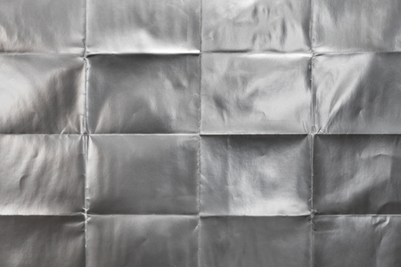 Sheet of silver paper folded, abstract background