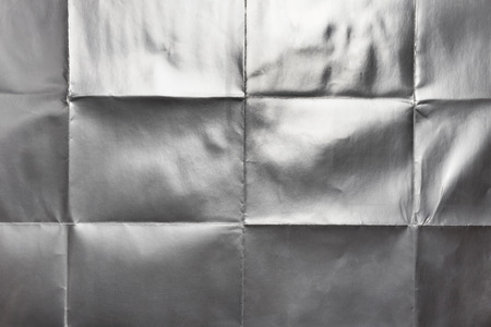 Sheet of silver gift paper folded, abstract background