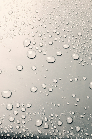 Surface with water drops, background