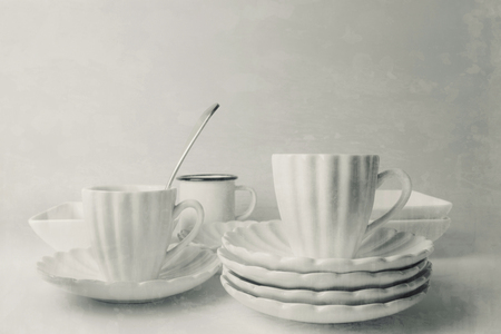 White ceramic coffee cups, grunge texture background 版權商用圖片
