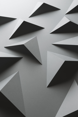 Macro image of gray geometric shapes, three-dimensional effect, abstract background