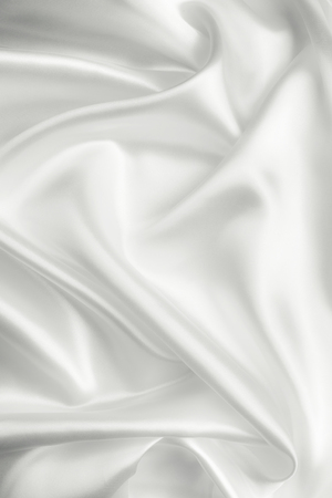 Elegant white satin silk with waves, abstract background Stock Photo