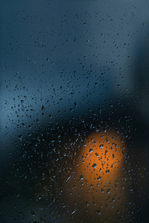 Lights in the night but outside it rains, raindrops on the window Reklamní fotografie